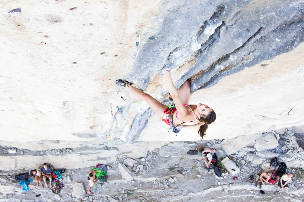"Brieuc Deléage captures Maelys Agrapart as she chalks up climbing  ""Les Colonnettes"" 5.13a in Ceuse, France"