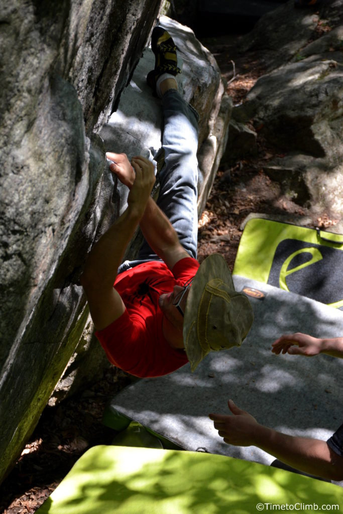Sam Dixon bouldering meat and potatos in Nine Corners Lake climbing