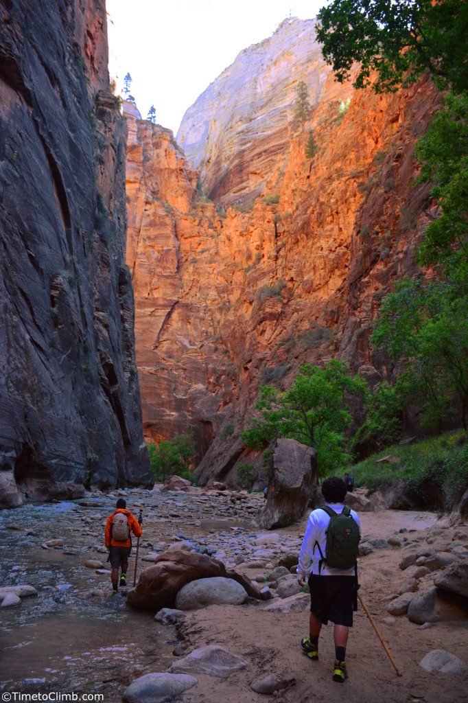 Kevin & Jay walking into the Zion narrows at Sunrise in Zion national park