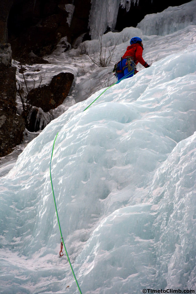 male climber rope trailing on standard route