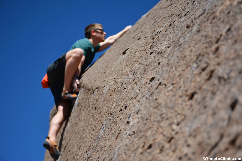 Andrew Messick with the undercling on Heavenly Path V1 in the Happy Boulders of Bishop California