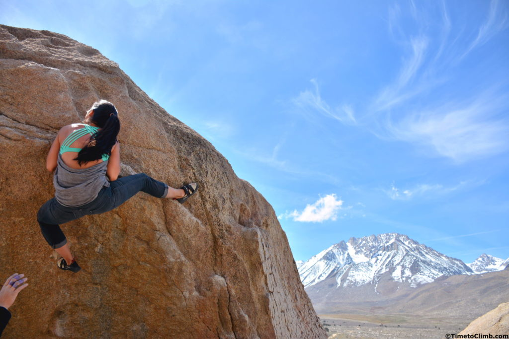 Ann Marie climbing with long hair in Bishop