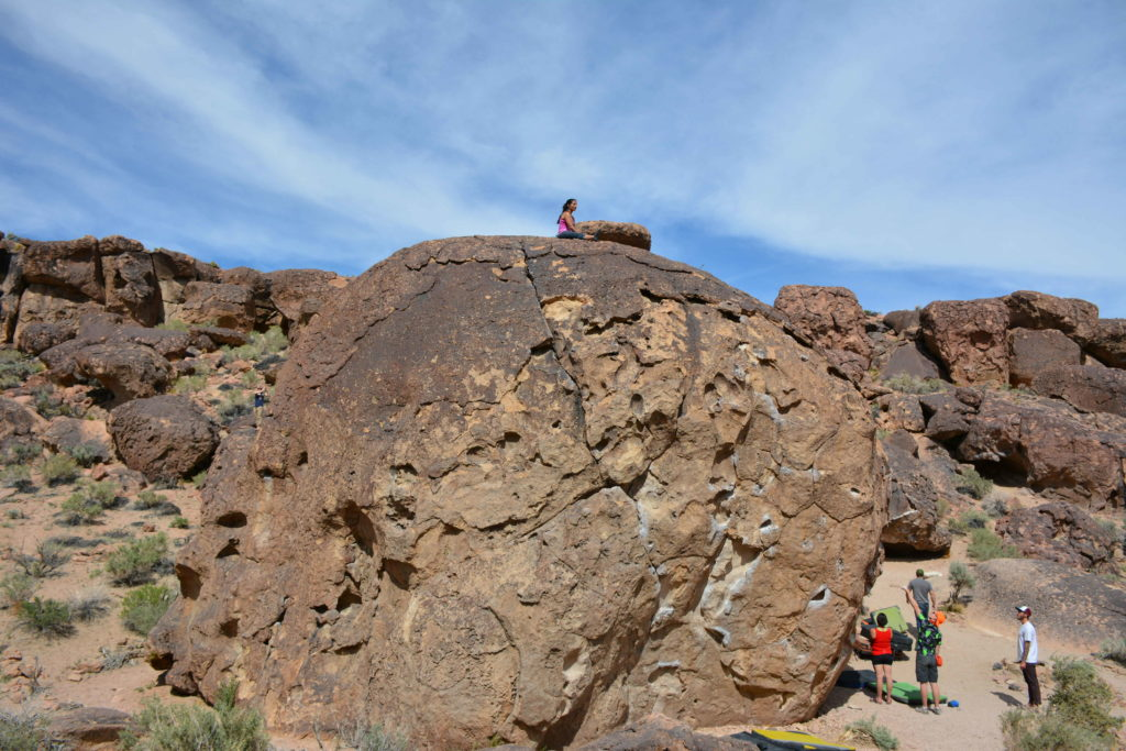 Ann Marie on the top of the Saerengti boulder at the Happy Boulders in Bishop California