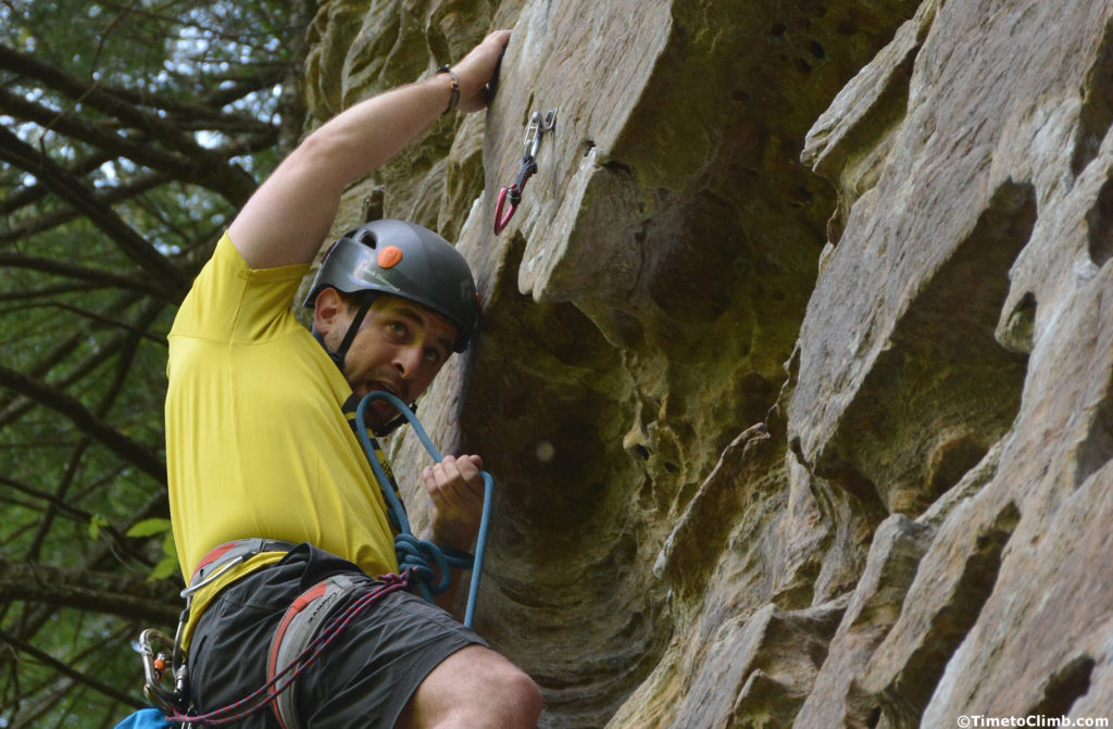 "Corey Day going for the clip on ""Getting Lucky in Kentucky"" climbing at Muir Valley in Red River Gorge"