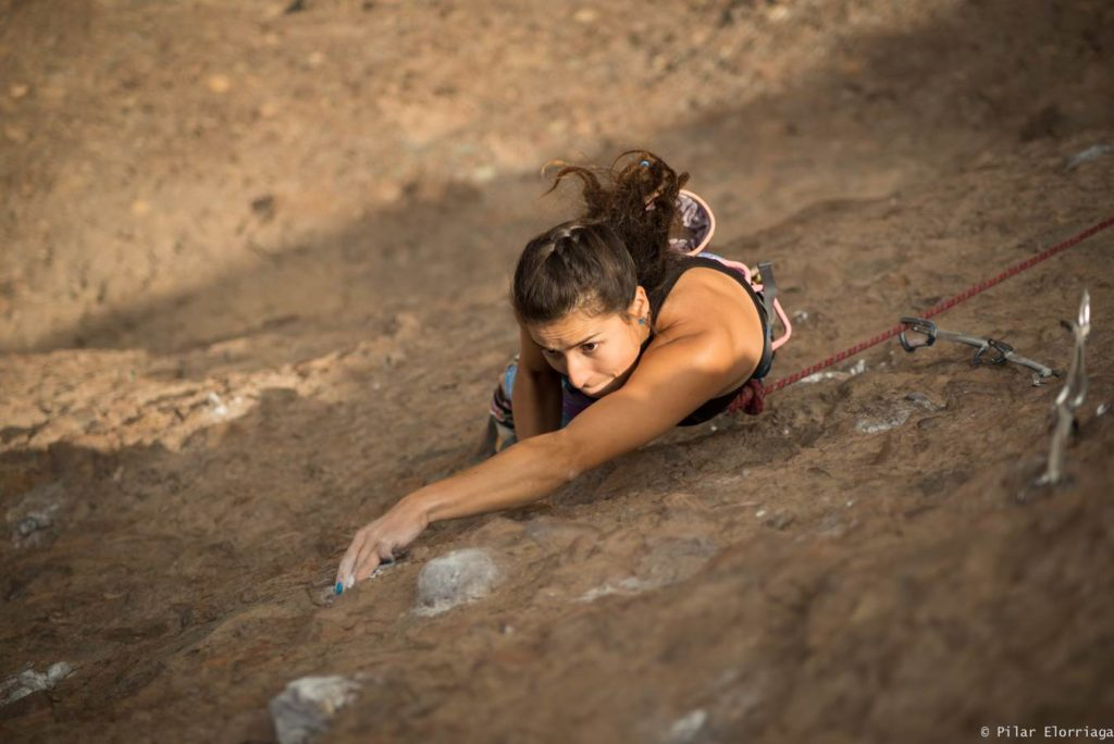 Gabriela Ulisse climbing with long hair in Chile
