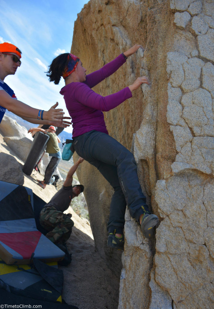 Michele DeVincentis bouldering with long hair in Bishop