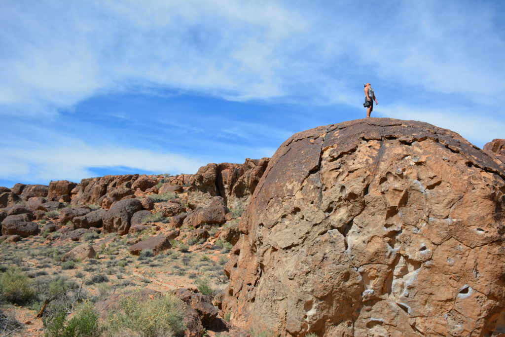 Nicholas Hernandez on top of the Serengeti Boulder Climbing in Bishop