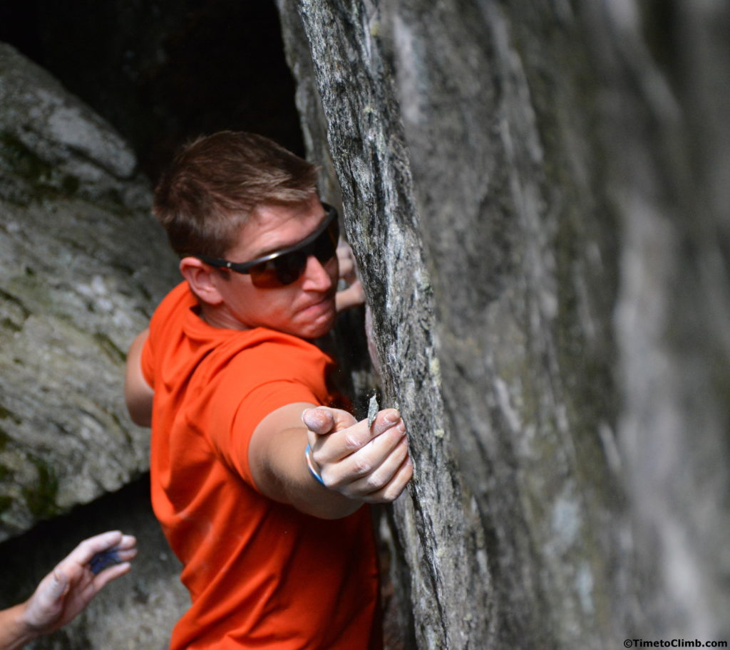 Andrew Messick realizing that part of his hold just chipped off in the middle of bouldering in Smuggler's Notch Vermont