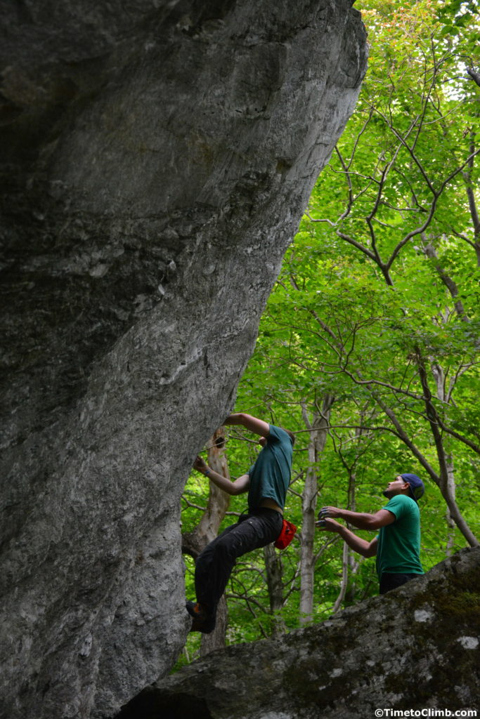Andrew Messick tarting his way up the Fin V2 bouldering in Smuggler's Notch Vermont