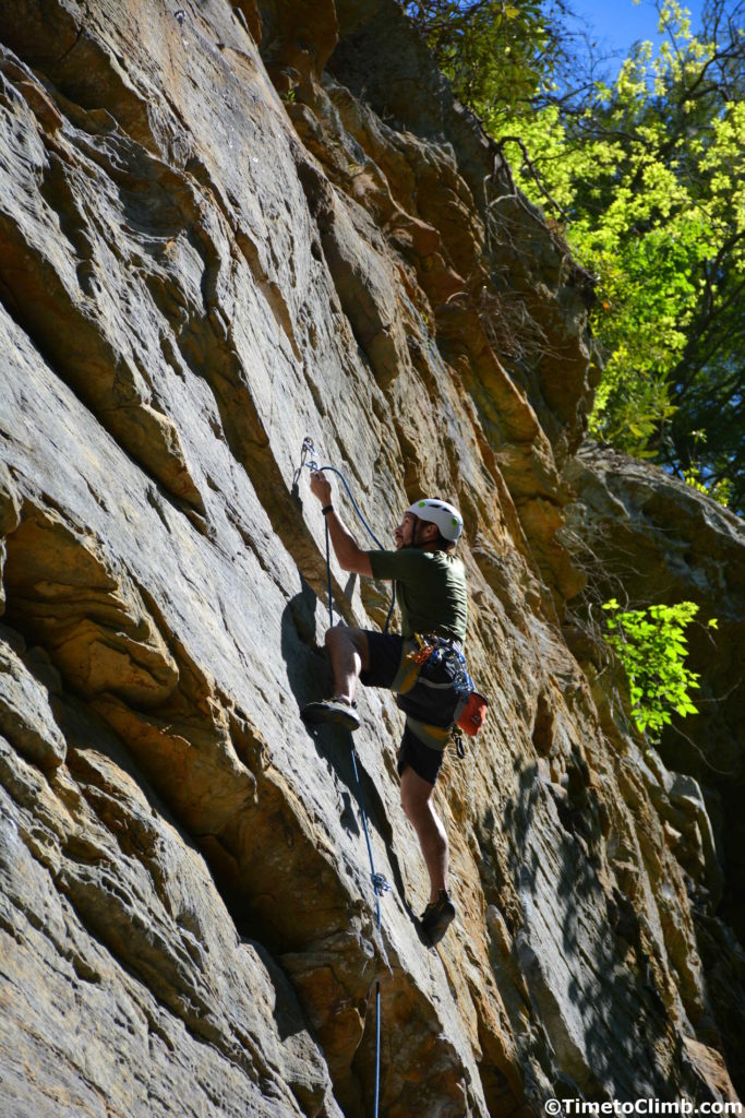 Nicholas Hernandez Clipping in the rope while climbing in Red River Gorge