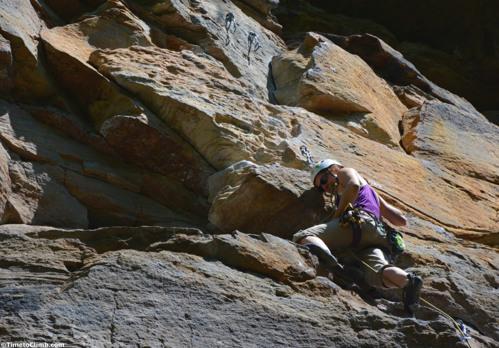 Svet biting the rope while climbing Bruise Brothers wall in Muir Valley