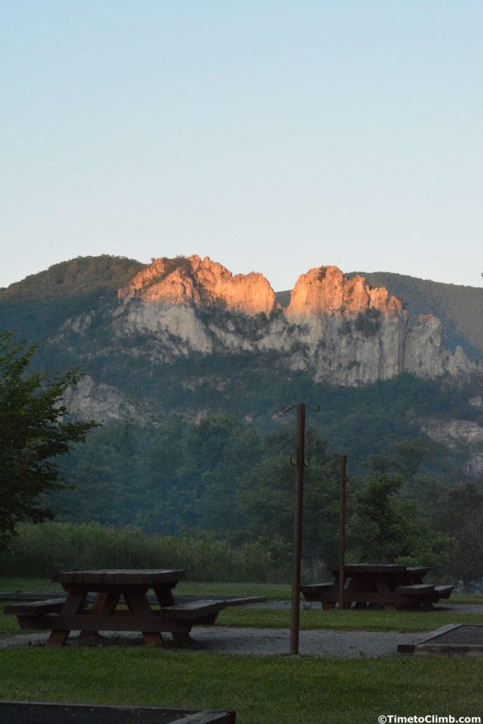view of the sunset on seneca rocks from seneca shodows campground