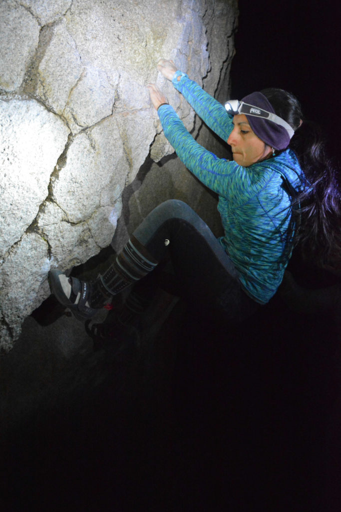 Ann Marie doing some night climbing on the Get Carter boulder - climbing in Bishop