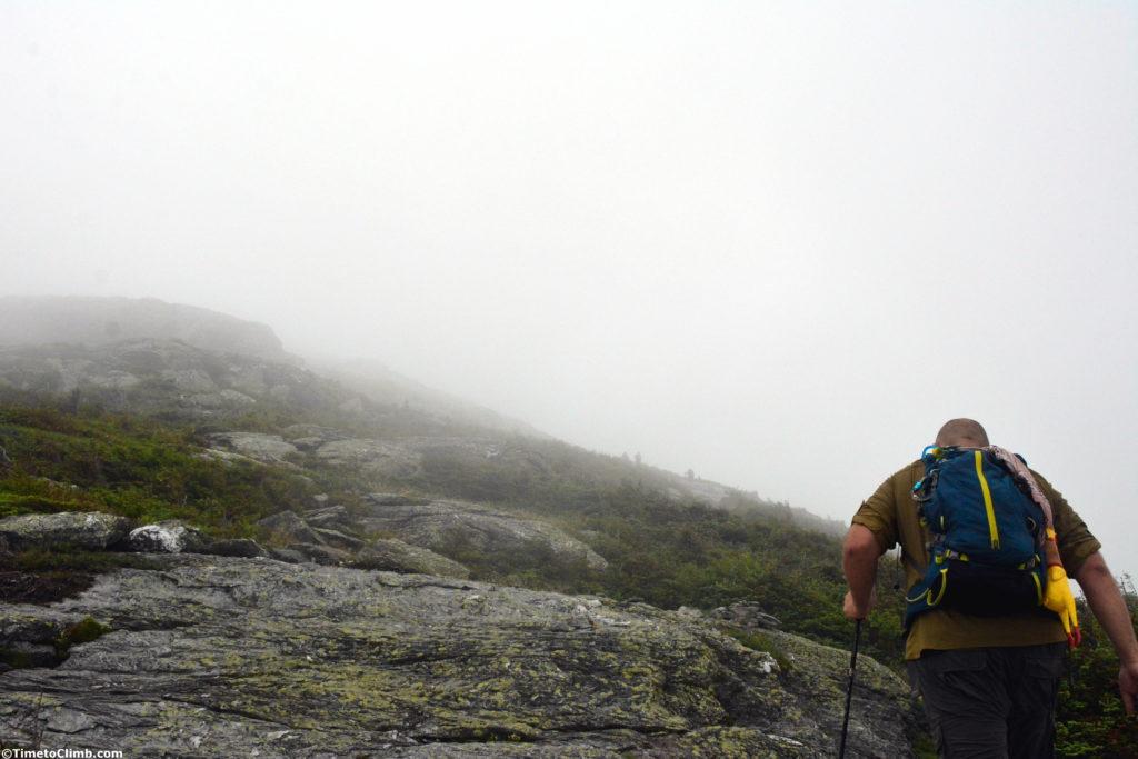 Dan Kasper hiking up Mount Mansfield VT above treeline