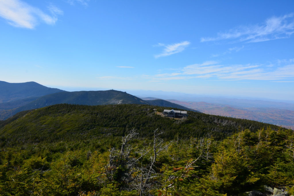 Hope in the form of AMC's Greenleaf Hut teases hikers during their descent of Mount Lafayette.