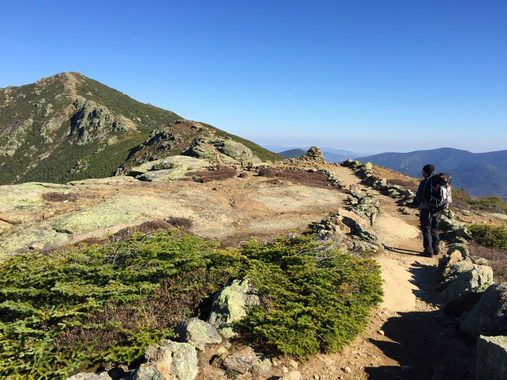 Nicholas Hernandez makes his way towards Mount Lincoln, being sure to stay on the marked trail.