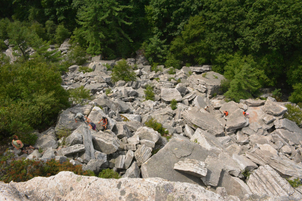 hikers climbing Bonticou