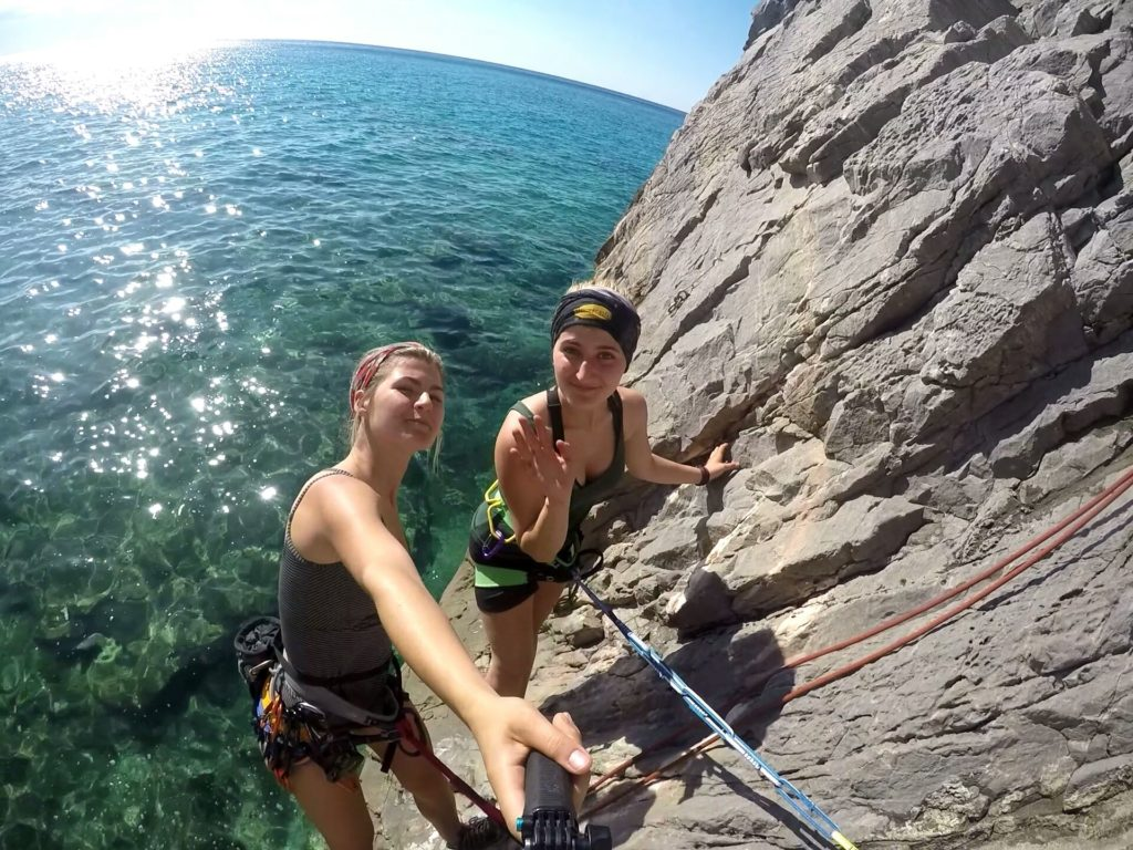 belay station above the water climbing Finale Ligure