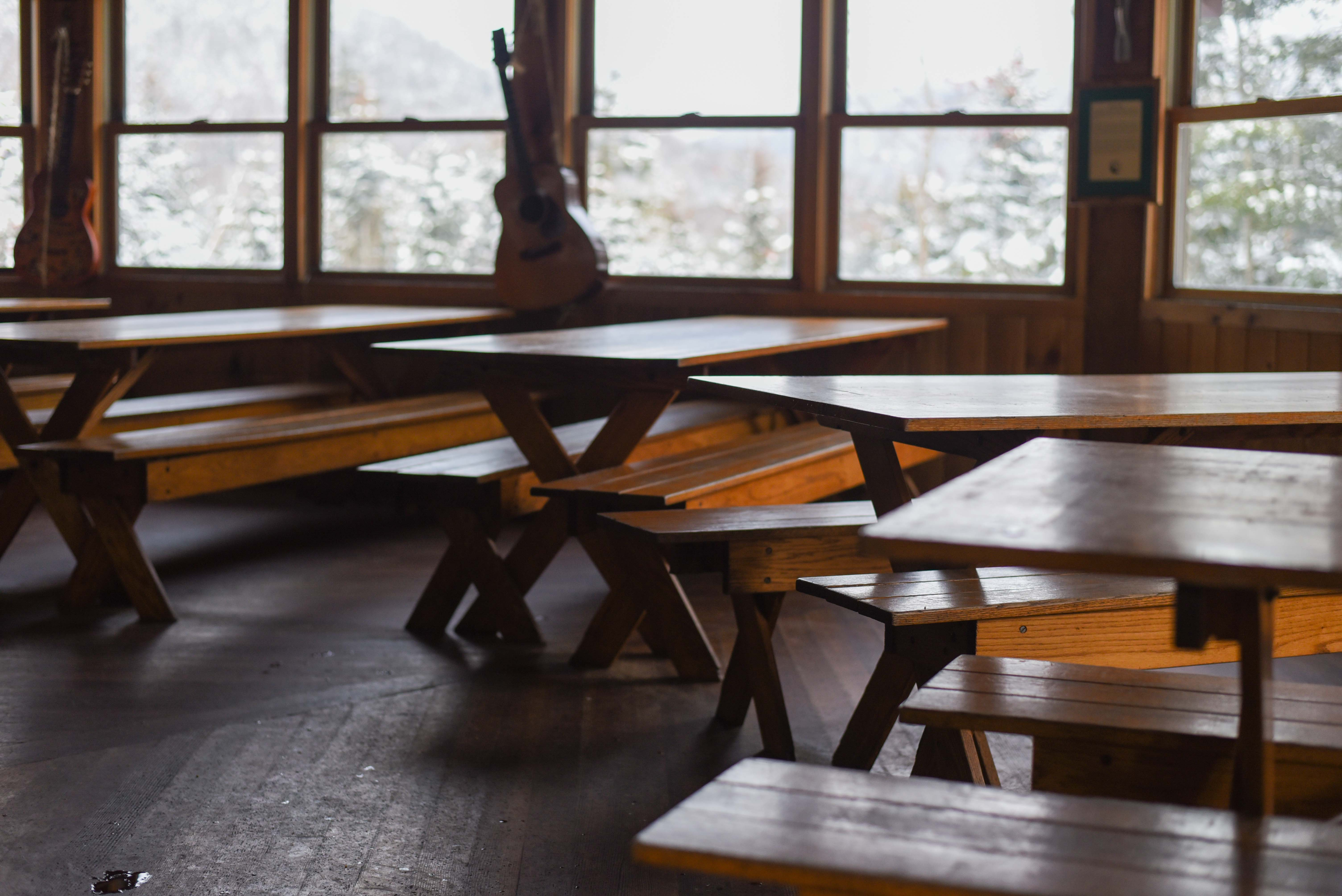 The picnic tables inside the main building hugging the windows